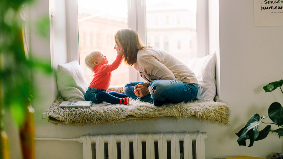 mother and baby near radiator